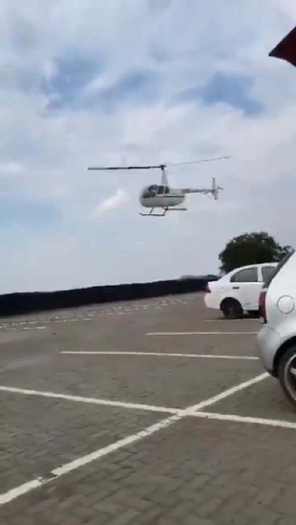 parents use helicopter to bring student's bag
