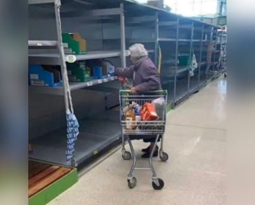 Photo of Old Woman Looking Through Empty Shelves at Grocery Store Breaks Hearts