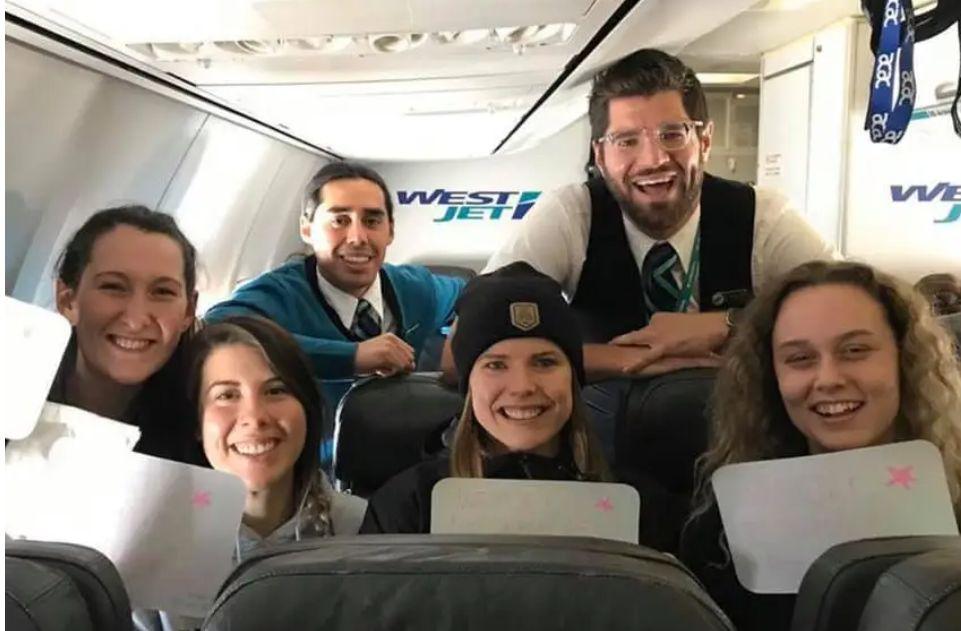 impromptu graduation party on airplane