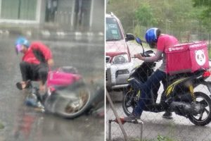 FoodPanda Rider Slips in Heavy Rain, Picks Himself Up to Continue with Delivery