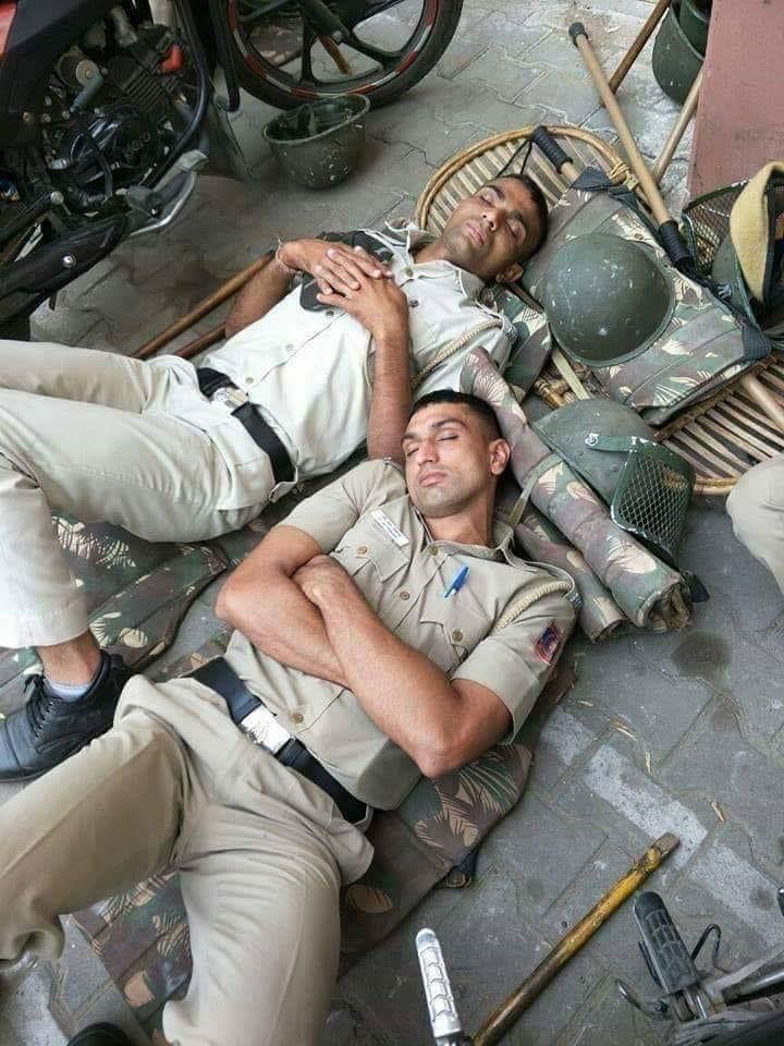 cops sleeping on ground