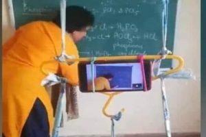 Teacher Praised for Creating Makeshift Tripod to Do Online Classes