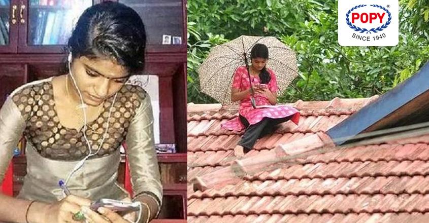 student studies on roof