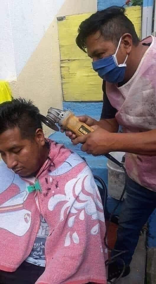 barber uses angle grinder