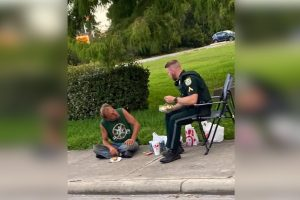 Florida Sheriff's Deputy Goes Viral as He Shares Dinner with Homeless Man