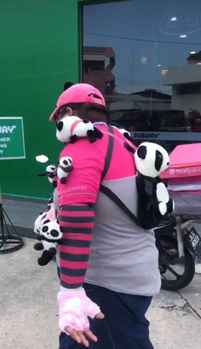FoodPanda rider wearing panda plushies